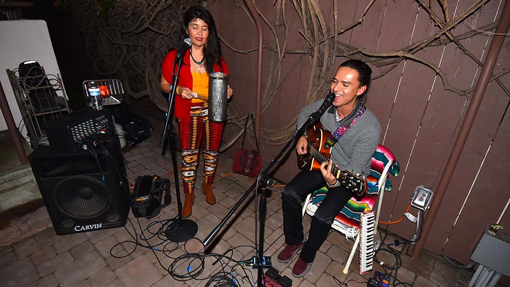 Fabio Alejo Rojas (right), a neighbor of Sandy Naranjo and Andrew McKercher, entertains patrty-goers with his Refugio Music group.