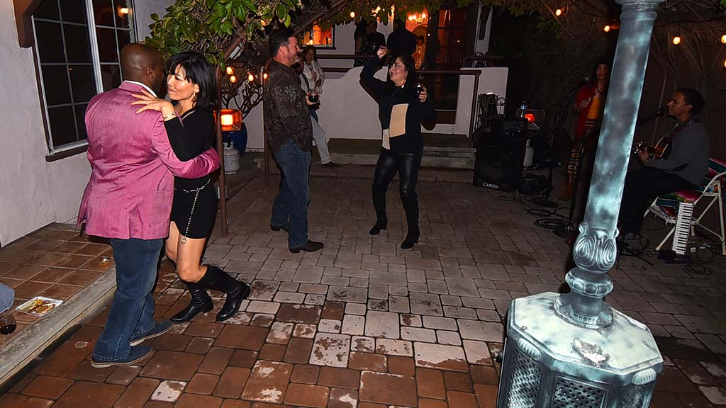 UFCW Local 135 party-goers dance in the back yard patio of Sandy Naranjo and Andrew McKercher.