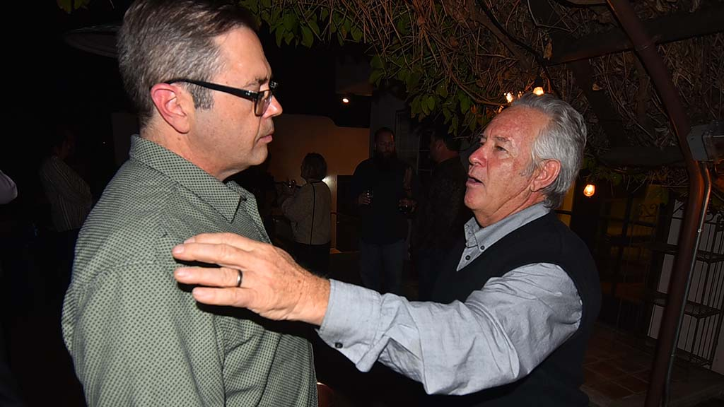 Brent Beltrán discusses labor politics with Jerry Butkiewicz (right), former secretary-treasurer of the San Diego-Imperial Counties Labor Council.
