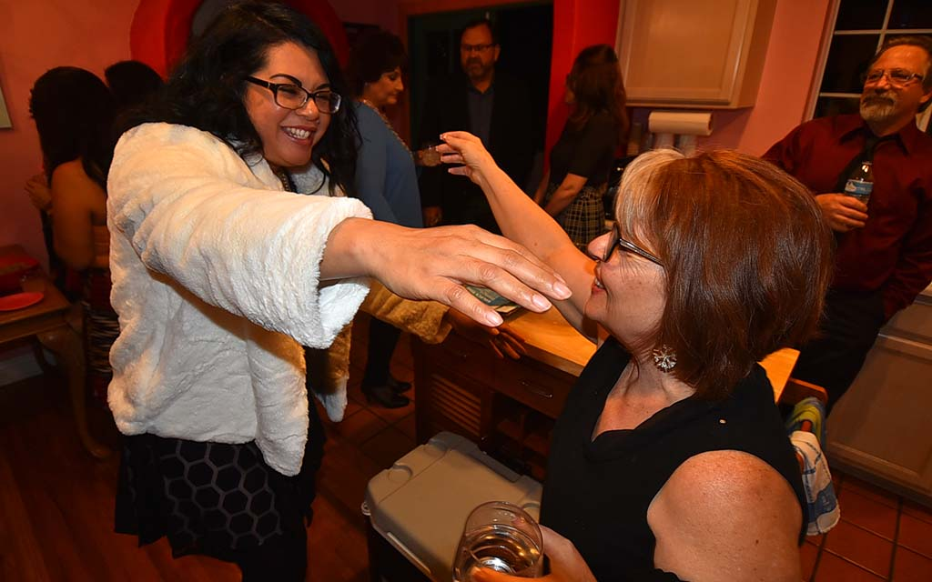Jessica Lopez, wife of new Local 135 Vice President Chris Lopez, reaches out to embrace Debbie Principe (right) who took party in Kasparian protests.