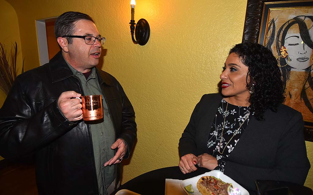 Brent Beltrán shares snacks and chat with Maribel McKinze, new recorder for UFCW Local 135.