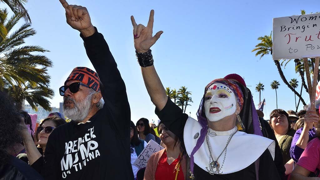 Activist Manny Aguilar (left) and Sister Ida of the Sisters of Perpetual Indulgence show support of a speaker at the rally at the Women's March San Diego.