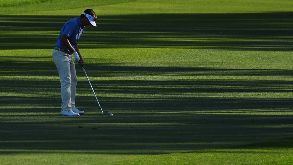 Hank Lebioda takes a shot amid the patterns of shade on the 18th of the Farmers Insurance Open.