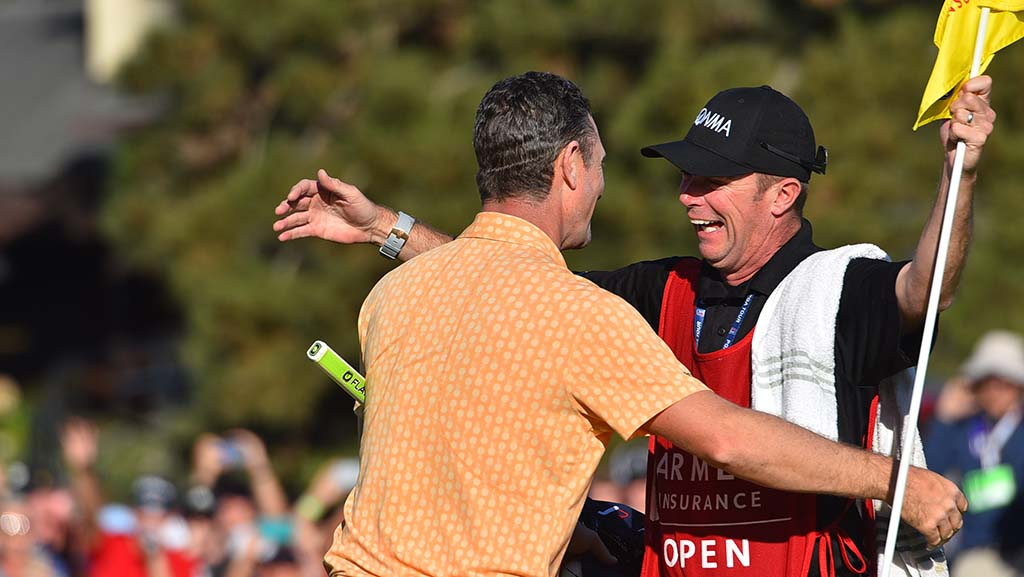 Jason Rose and his caddie embrace after winning the Farmers Insurance Open at Torrey Pines Golf Course.