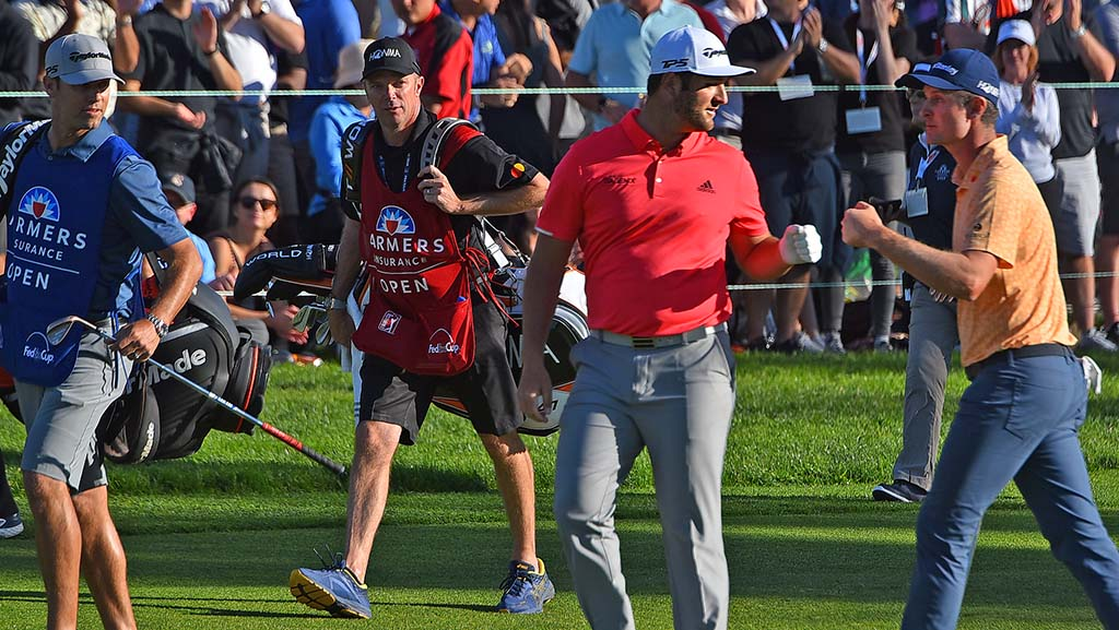 Jon Rahm (in red) and Jason Rose fist bump as they head to the 18th hole of the Farmers Insurance Open on Jan. 27, 2019.