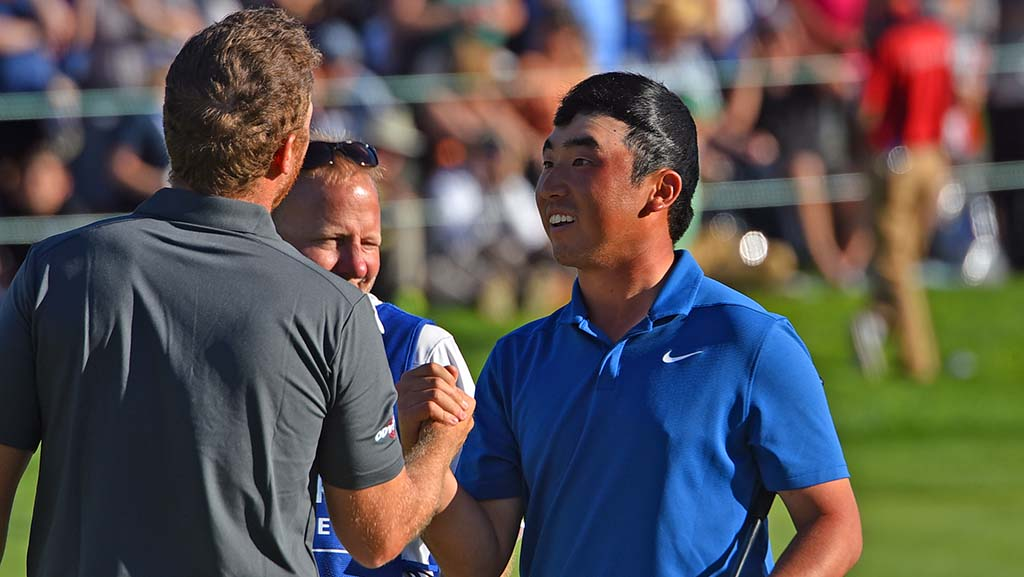 Doug Ghim's sunburn shows after he removed his cap. He shakes hands with Talor Gooch.
