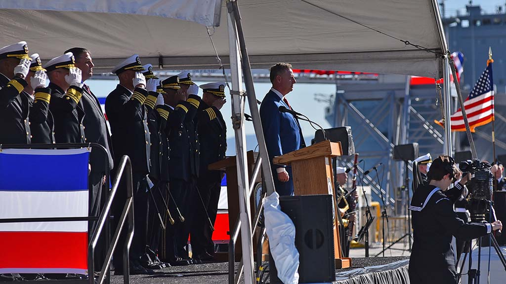 U.S. Rep. Scott Peters and Navy officers receive the color guard from the USS Michael Monsoor and SEAL Team Three.