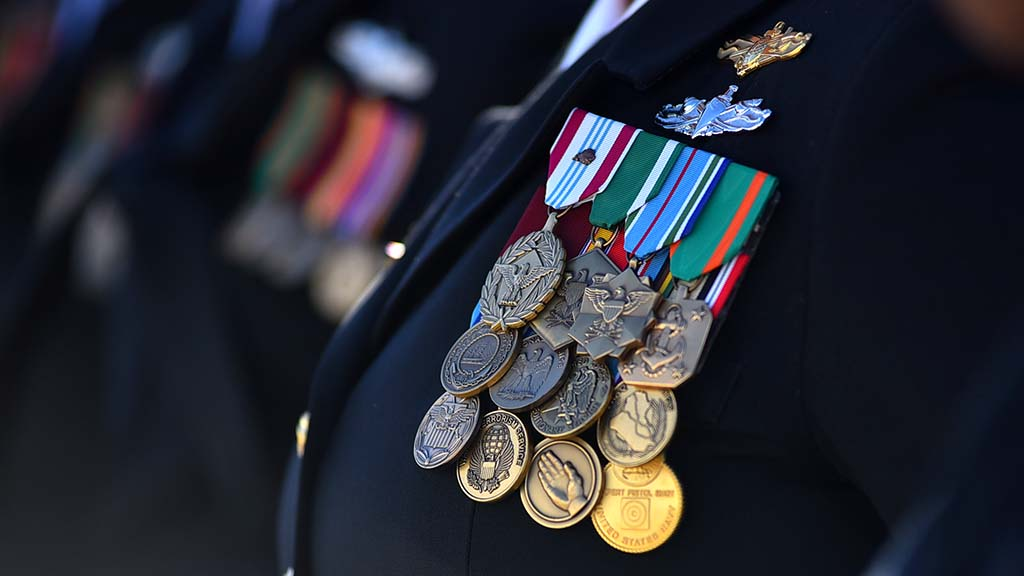 The crew of the USS Michael Monsoor display their numerous medals at the ceremony.