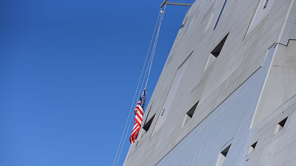 The American flag is raised for the first time on the USS Michael Monsoor at the North Island Naval Air Station on Coronado.