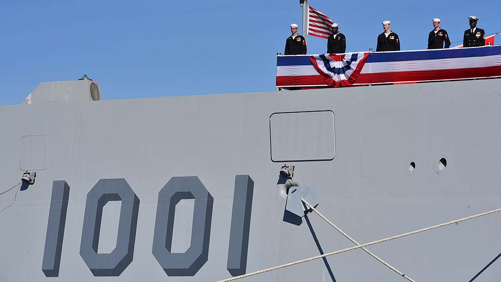 Sailors of the USS Michael Monsoor stand watch on their new ship.