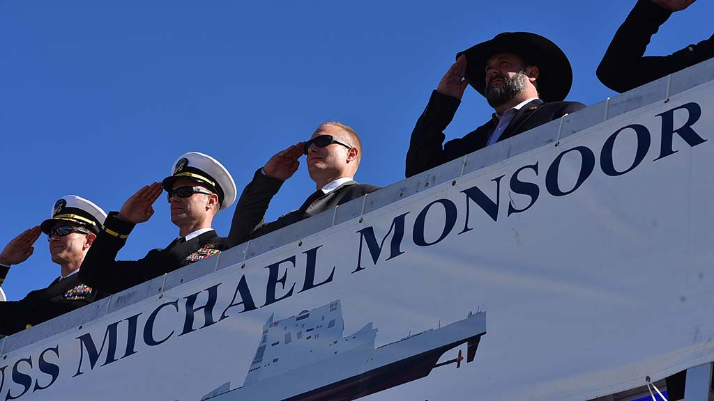 Retired Navy SEALS honor their fallen team member whose name was given to the newest Navy ship.