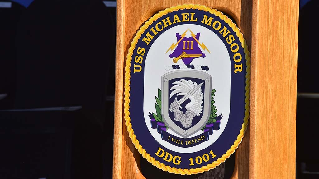 The crest of the USS Michael Monsoor incorporates a wing of St. Michael the Archangel.