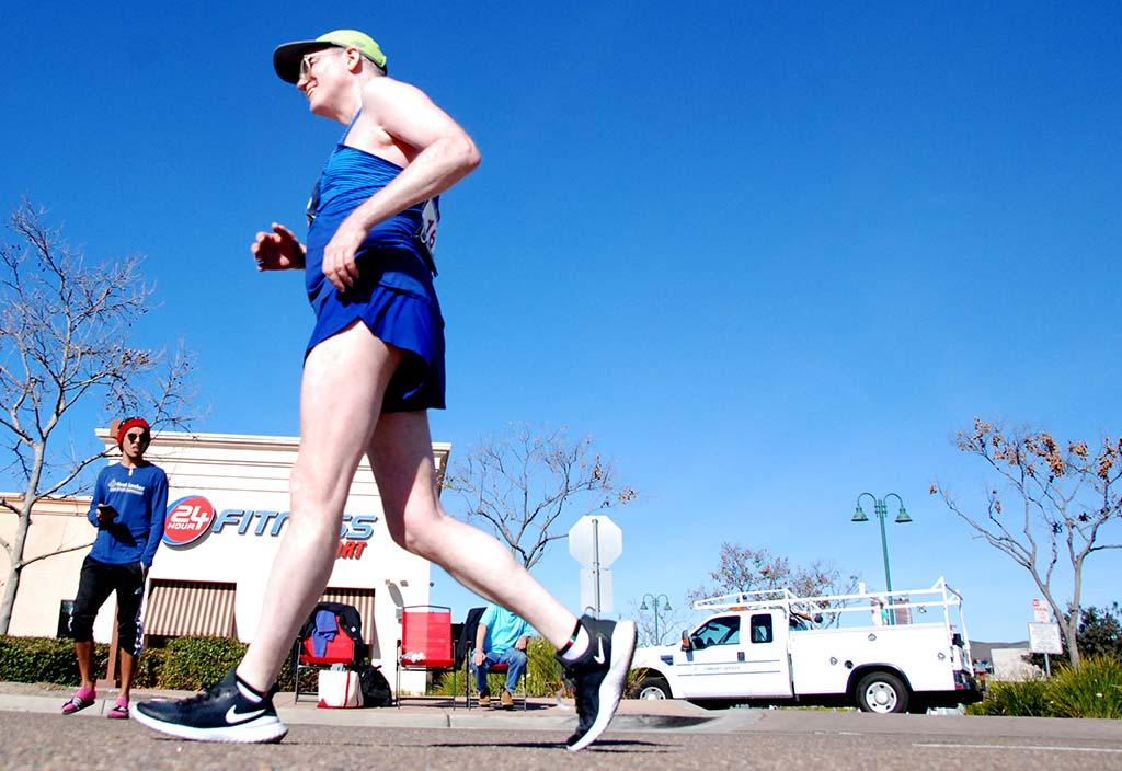 Bruce Logan, 54, of New York passes 24 Hour Fitness during one of 40 laps of 50K race walk in Santee.