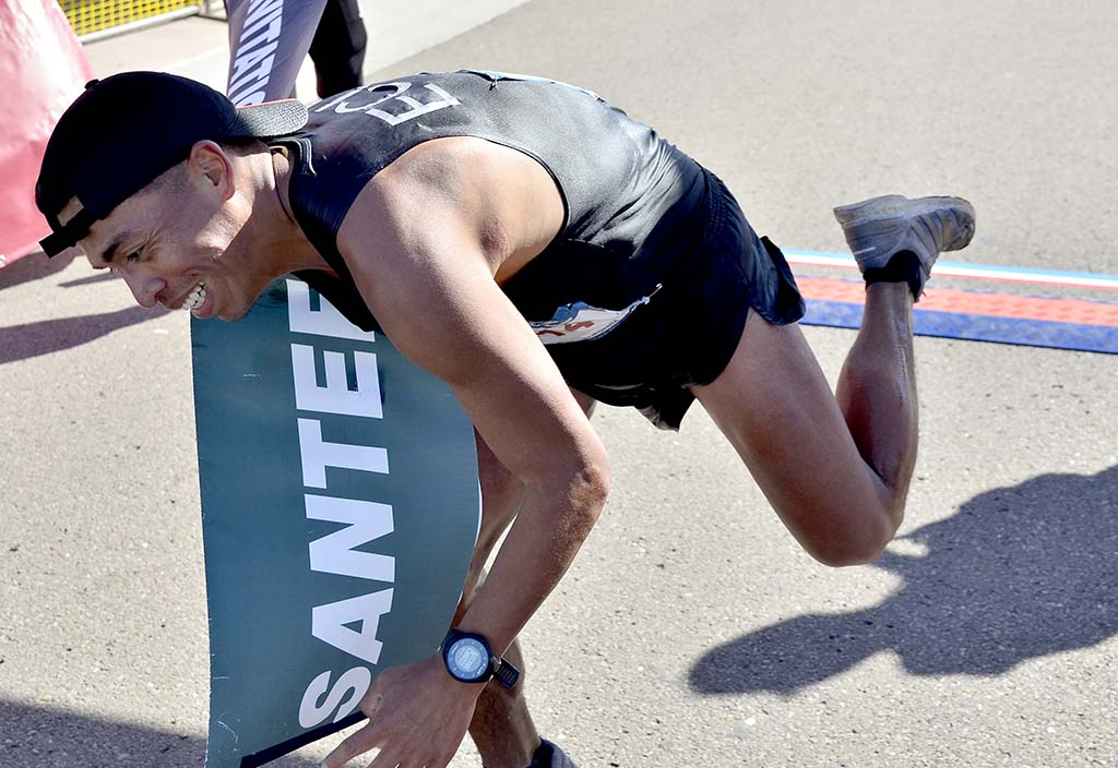Ecuador's David Velasquez begins falling after being the first overall finisher in the Santee 50K.