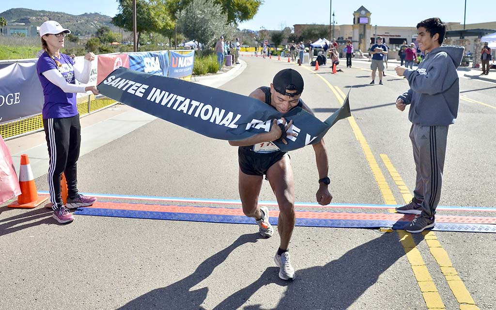 David Velasquez plows through finish tape to win the Waterbridge Capital International 50km Challenge.