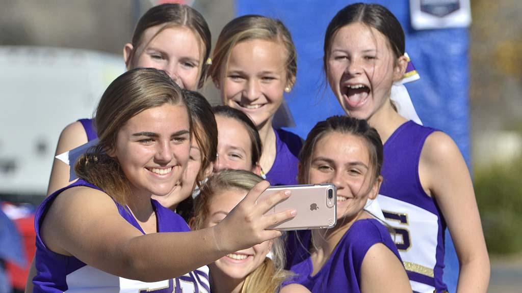 Santana High School cheerleaders record their group during USATF National 50K Race Walk Championships in Santee.