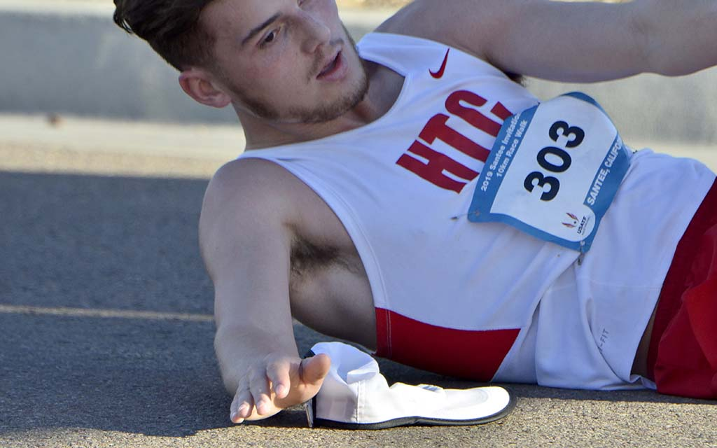 Logan Roberts Jr. collapses from exhaustion after his big personal record in the 10K race walk.