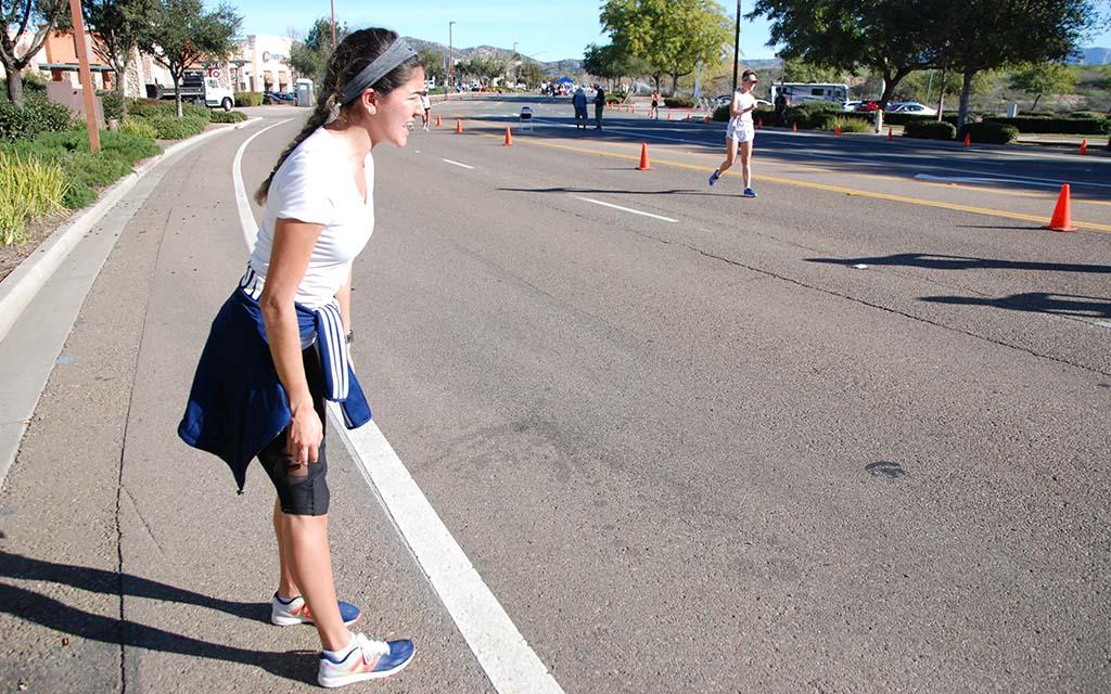 Nayeli Cisneros encourages her sister, Anali Cisneros, who went on to win the women's 20K walk.