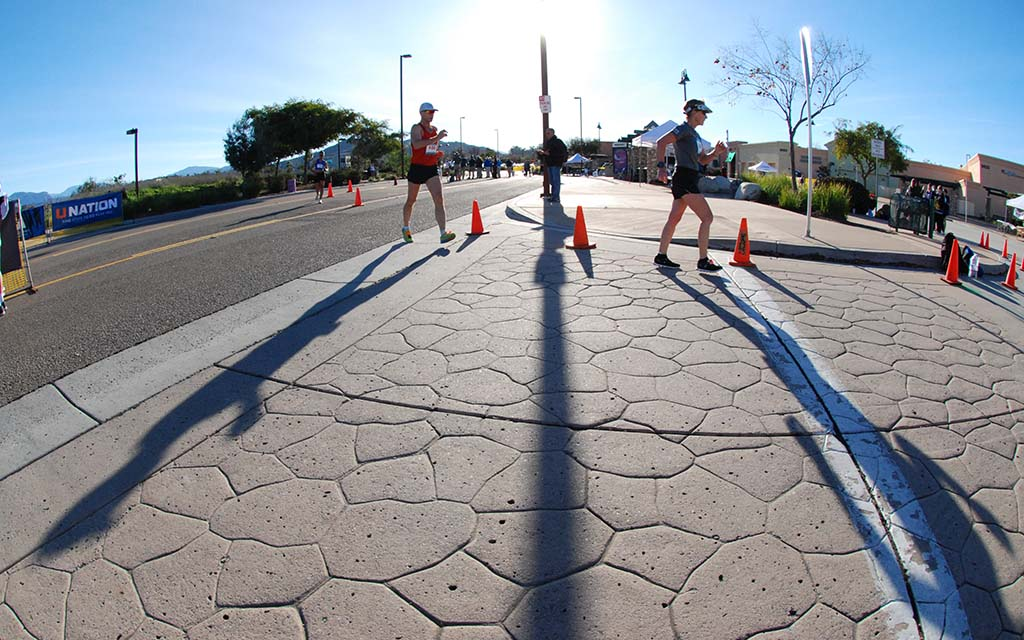 Walkers throw long shadows not long after 7:30 a.m. start of all races near Santee Trolley Square.
