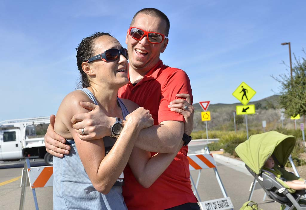 Patrick Casey of Reedsport, Oregon, catches his wife, Stephanie in his arms upon her finishing her first 50K.