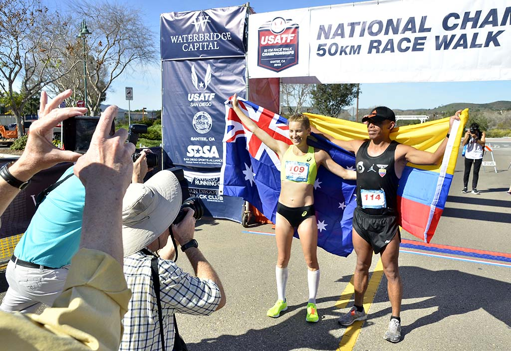 Photographers get the men's and women's 50K winners together — Claire Tallent of Australia and David Velasquez of Ecuador