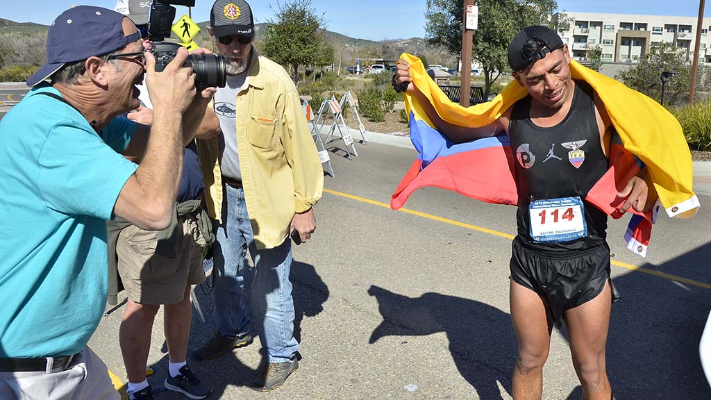 Paul Nestor photographs international men's champion David Velasquez after his 50K.