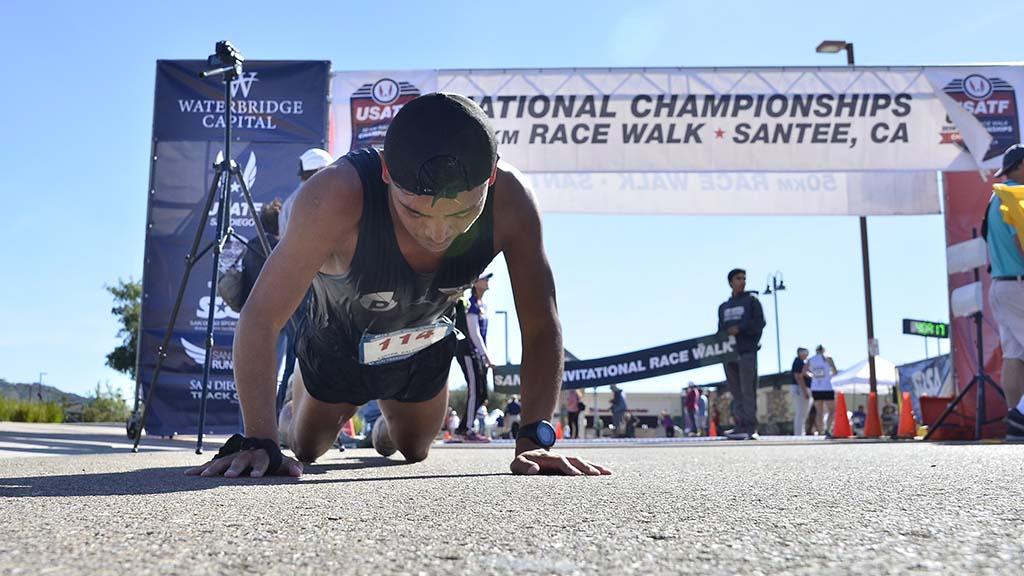 David Velasquez slowly gets up after winning a draining 50K race walk in Santee.