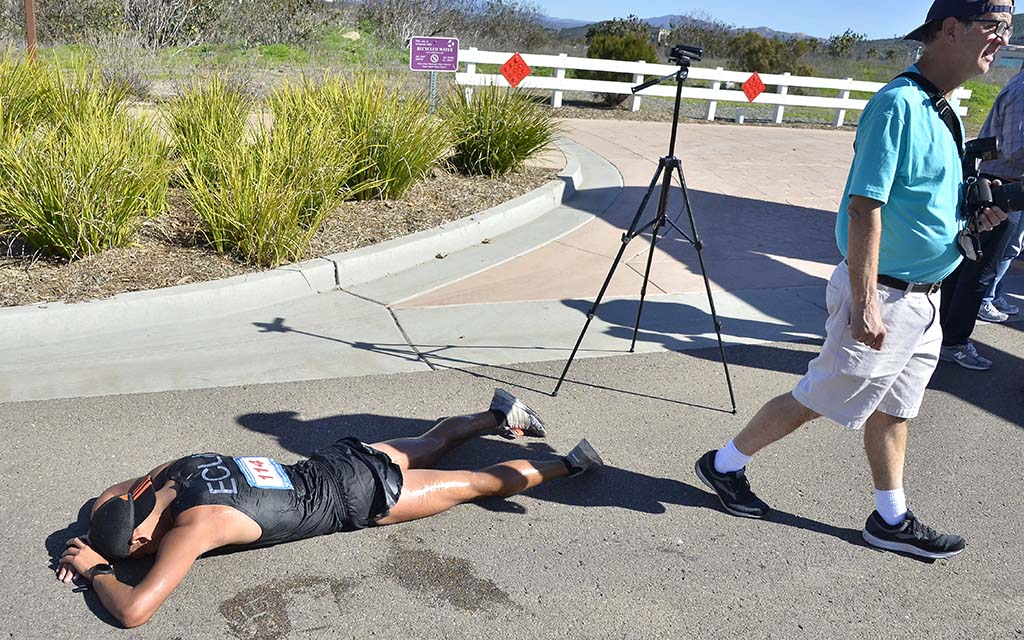 David Velasquez, exhausted on a hot day for race walkers, rests for a few moments after his 50K finish.