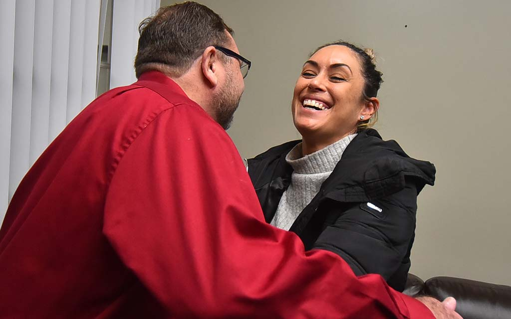 """Anabel Arauz, moving to embrace Todd Walters, says she congratulated Local 135 members at the grocery where she shops: """"Their faces just light up. ... I said: 'Good job, you guys. Your voices were heard.'"""""""