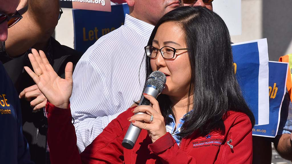 Carol Kim of the Building and Construction Trades Council demands payment for federal workers.