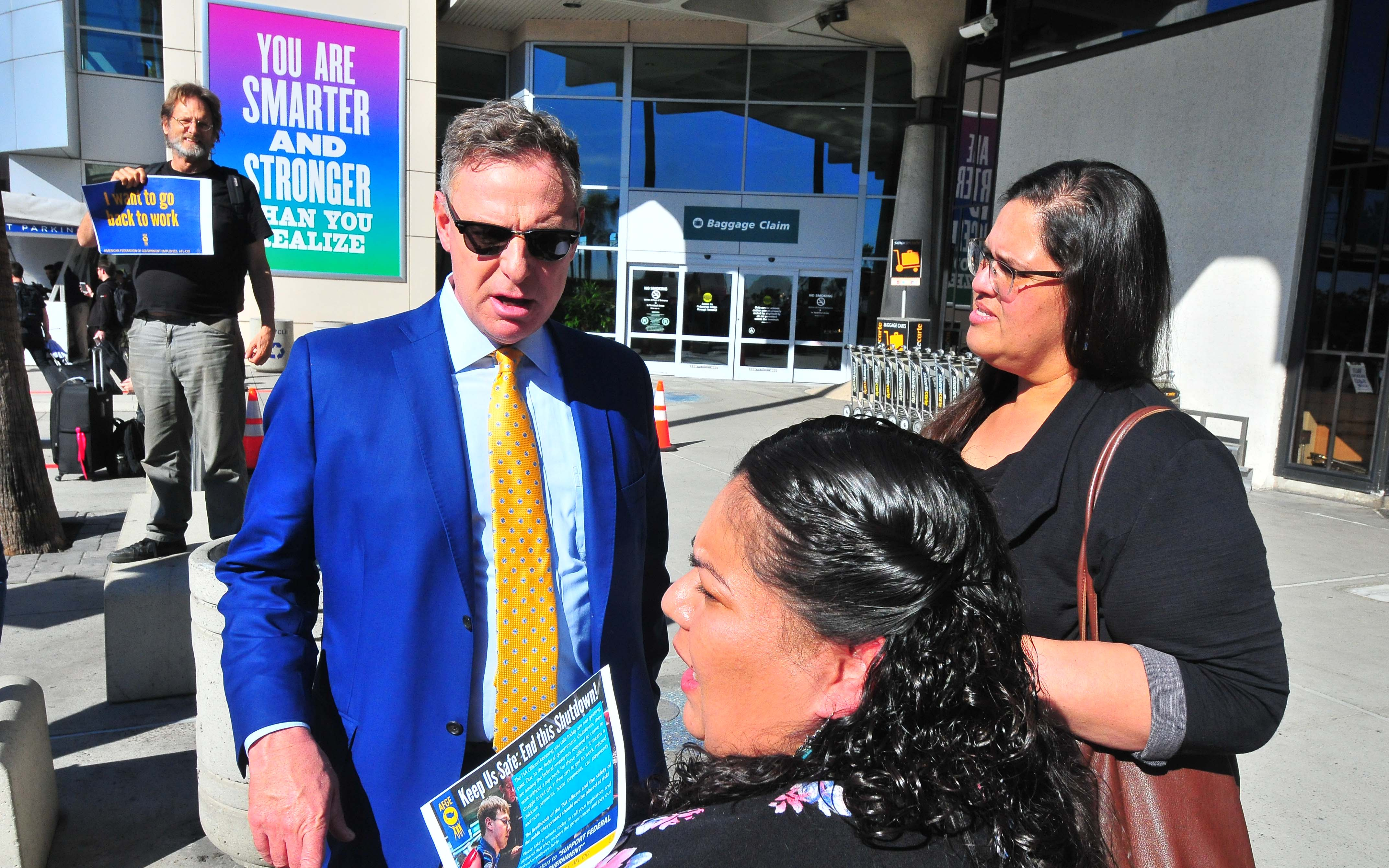 Rep. Scott Peters chats with Beatriz Garcia (left) and Genoveva Aguilar, an SEIU organizer seeking to unionize commercial real-estate security officers.