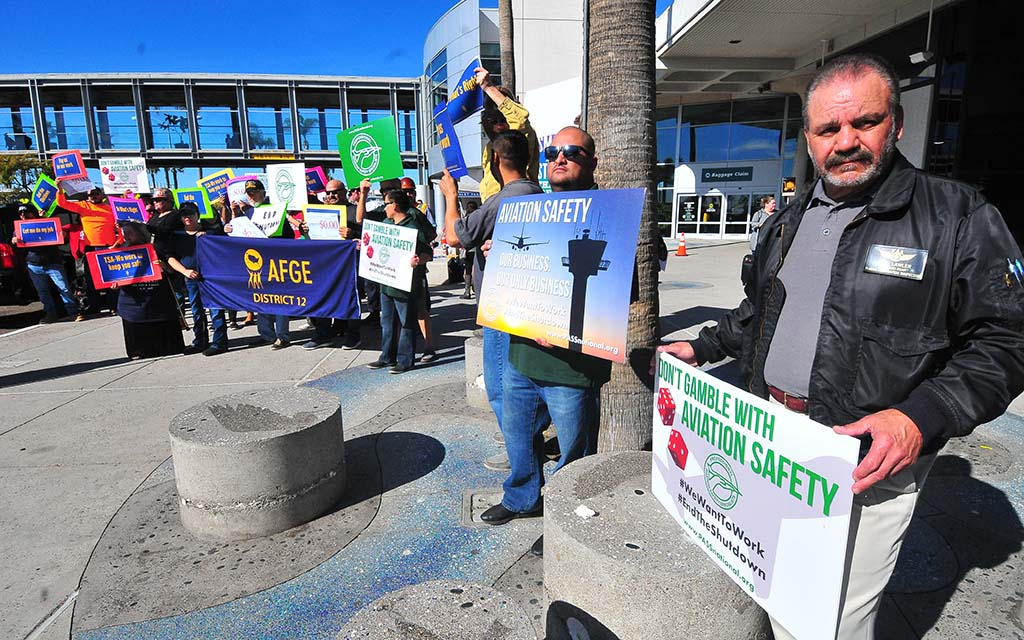 "FAA aviation inspector Art Lawler held sign: ""Don't gamble with aviation safety."""