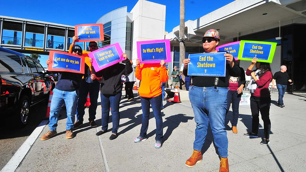 Ironworkers union members were among the first to display signs at San Diego International Airport.