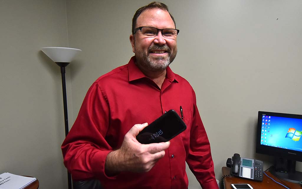 President Todd Walters holds cell phone previously used by Local 135 leader Mickey Kasparian.
