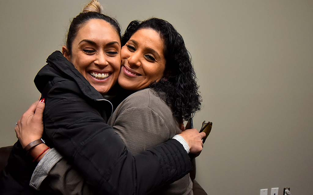 Maribel Mckinzie (right) hugs former Local 135 organizer Anabel Arauz, who was among four women who sued Mickey Kasparian.