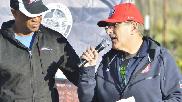 Tracy Sundlun (right) is still deeply involved in sports, such as the USATF National 50K Race Walk Championships last weekend in Santee, where he interviewed Olympian Willie Banks.