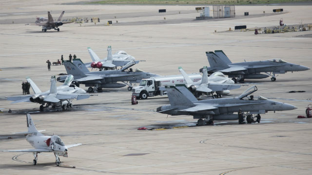 Ground crews fuel F/A-18 Hornets