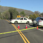 Sheriff's cruiser blocks the road near the residence