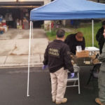 Bomb squad personnel examine the ordnance