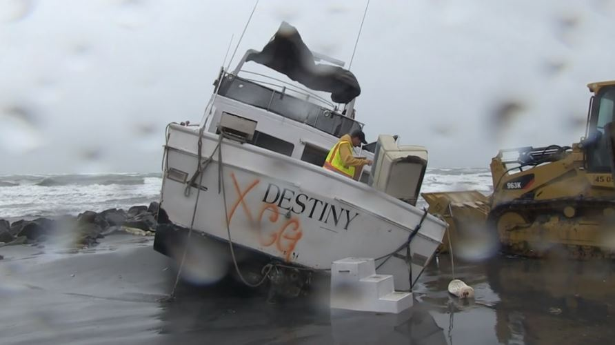 Derelict Yacht Washes Ashore at North Island During Storm