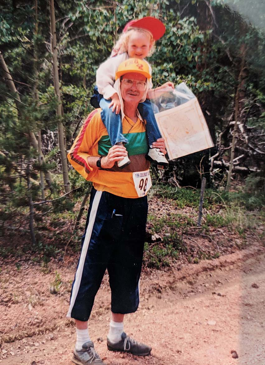 Jo Childs sits on her father Bill Gookin's shoulders at an orienteering competition.