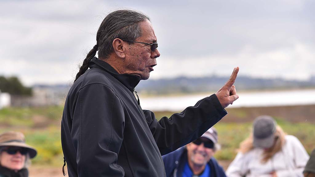 Stan Rodriguez, instructor at Kumeyaay Community College, spoke to visitors about original conditions of the marsh.