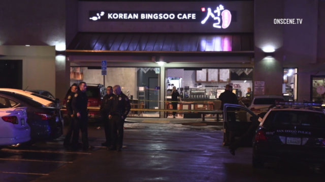 Police outside the restaurant where the shooting occurred.