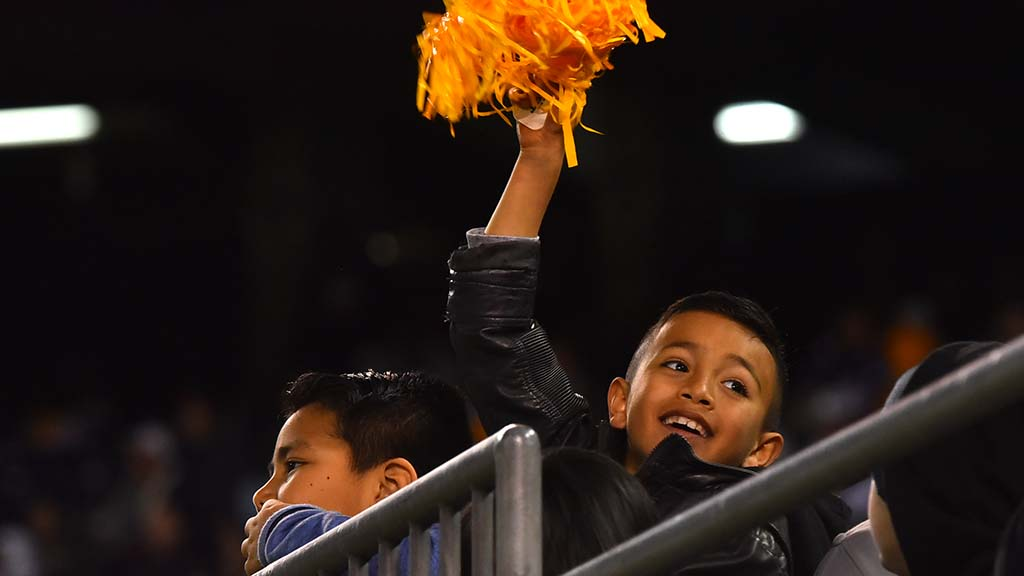 A young fan joins in the celebration of the San Diego Fleet victory.