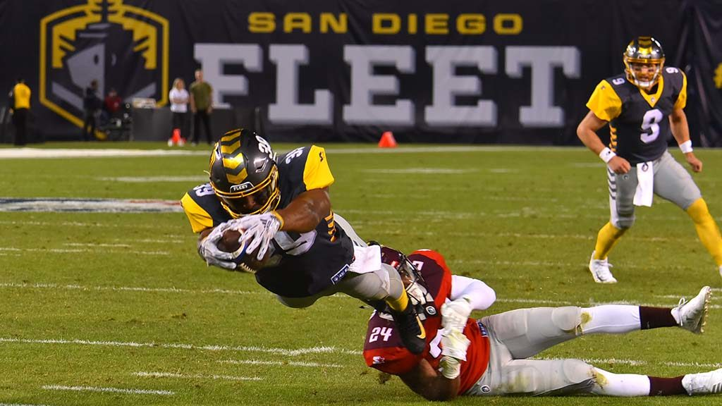 San Diego Fleet running bak Terrell Watson drives into the end zone to gain the two points after touchdown.