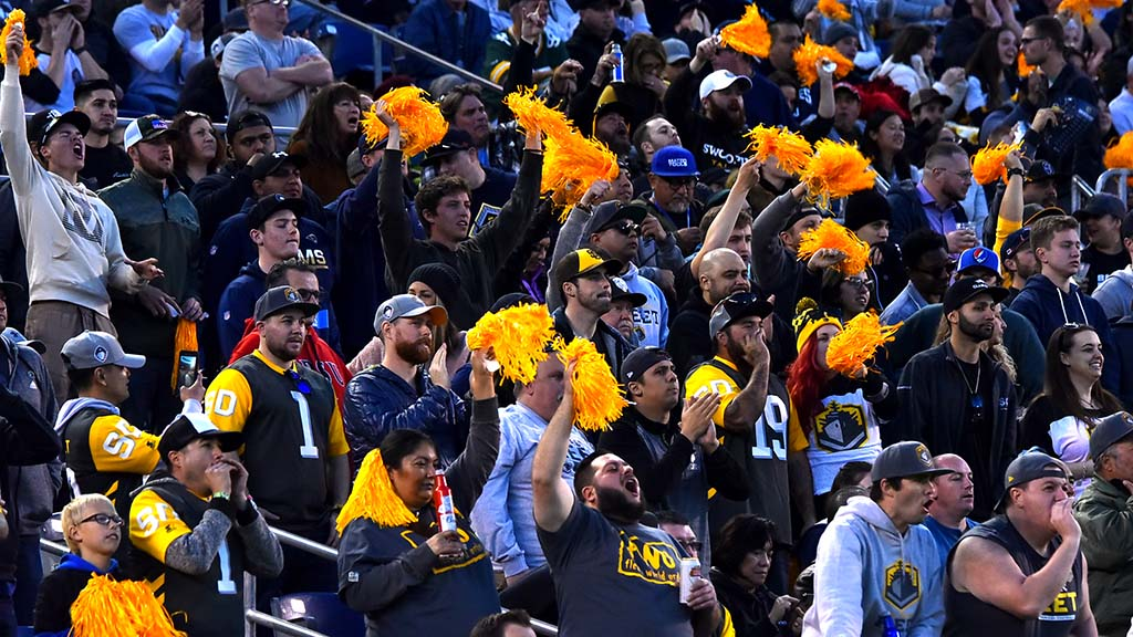 Sections of SDCCU Stadium were filled with enthusiastic fans, some wearing Charger and Padre caps.