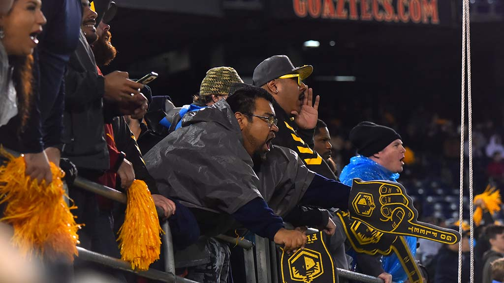 San Diego Fleet fans get enthusiastic as the team racks up points on the scoreboard.