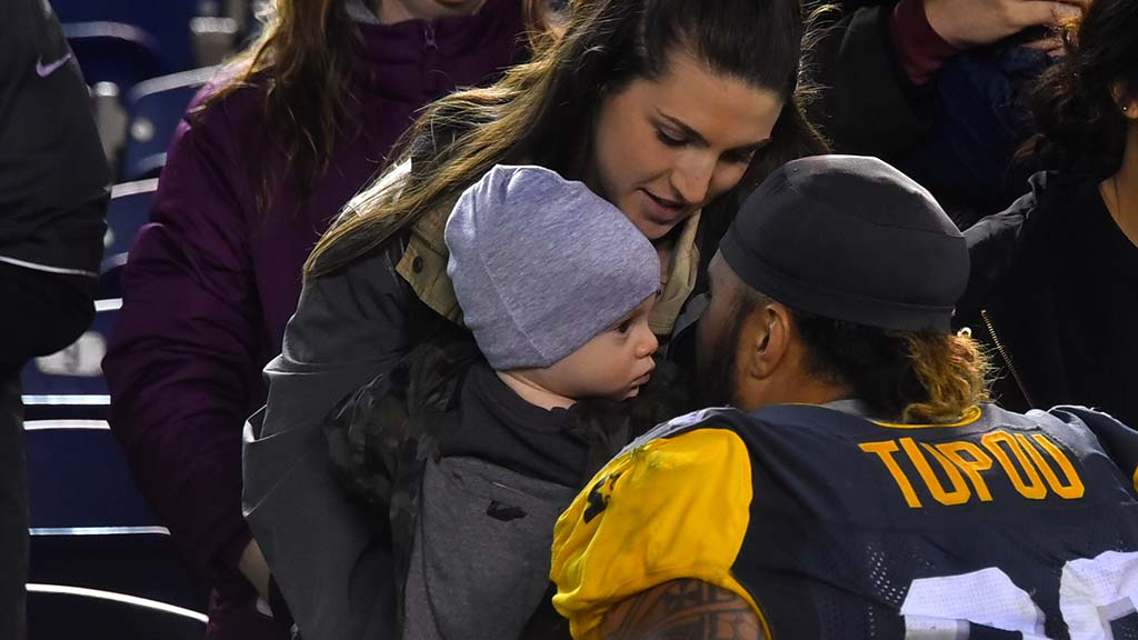Fleet defensive tackle Tani Tupou greet his baby after the game.