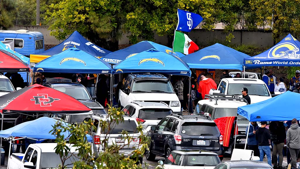 In the rain tailgaters brought out their Charger tents to cook up some meals before the game.