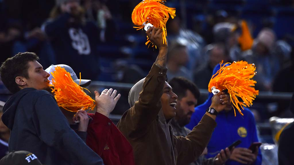 Fans used their yellow pompoms that were given away at the entrances to cheer throughout the game.